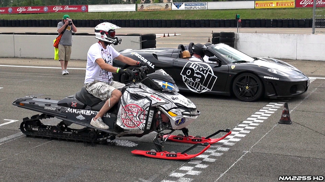 this snowmobile takes on two ferraris in a drag race
